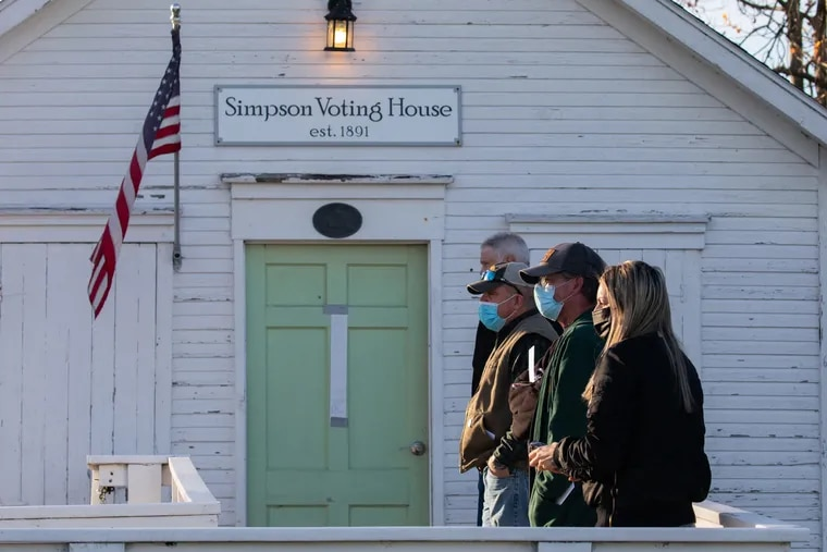 Voters waited in line outside the Simpson Voting House polling place on Tuesday, Nov. 3, in Derry Township, Pennsylvania. The first time the location was used for polling was 1891.