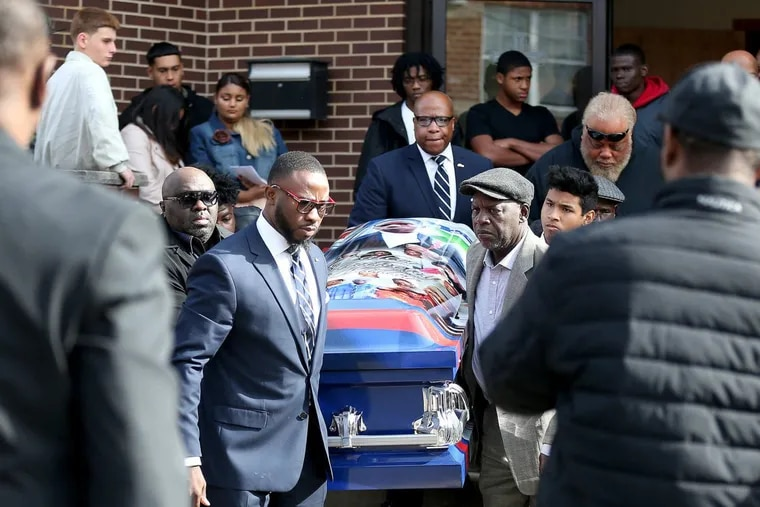 Pallbearers carry the casket of South Philly shooting victim Caleer Wilson at Love Kingdom Fellowship Church  in Philadelphia, PA on November 4, 2017.