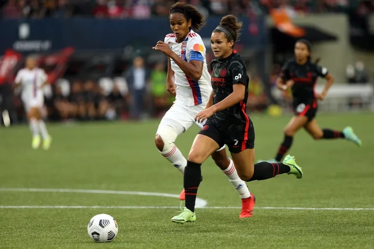 Portland Thorns striker Sophia Smith (right), a likely future starter for the U.S. national team, battled repeatedly against Lyon's star French centerback Wendie Renard in the final of the Women's International Champions Cup.