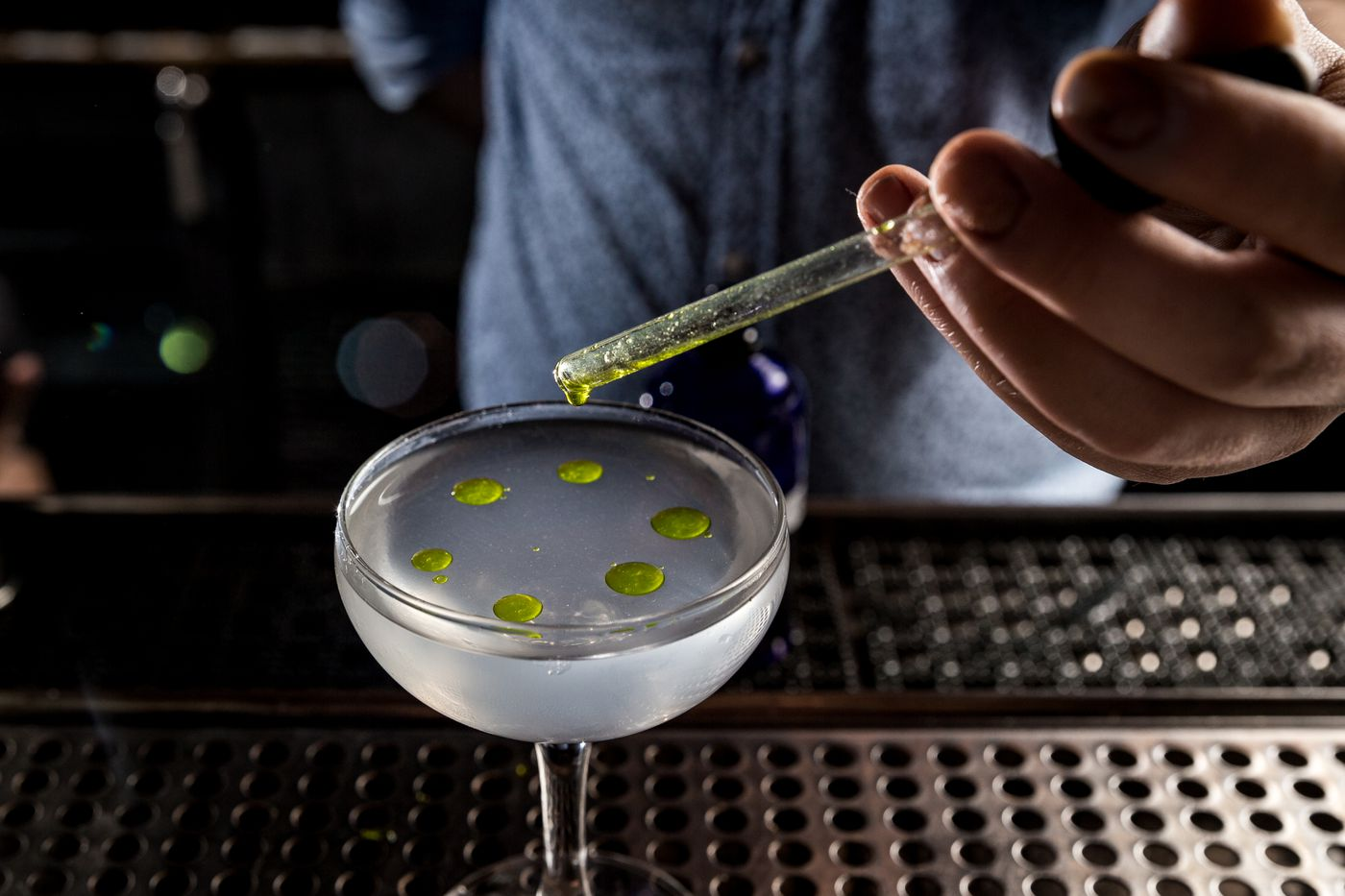 Franklin Bar's Little Mister Good Fortune stars a snap-pea-infused tequila stirred with celery-infused pisco, Brennivín aquavit, salers, sweet vermouth, lemon cordial, and celery and orange bitters. Garnished with pickled red onion, the drink is finished with drops of cilantro oil.