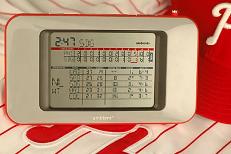 Ambient Devices Baseball ScoreCast is a sleek personal electronic scoreboard that sits on a desk, always on, tracking every pro baseball game.