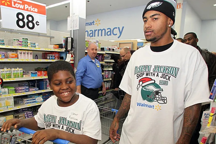 Eagles receiver DeSean Jackson and Umar Ransom prepare to shop during a shopping spree for underprivileged kids at the Walmart on South Christopher Columbus Blvd on Tuesday, December 3, 2013. (Yong Kim/Staff Photographer)