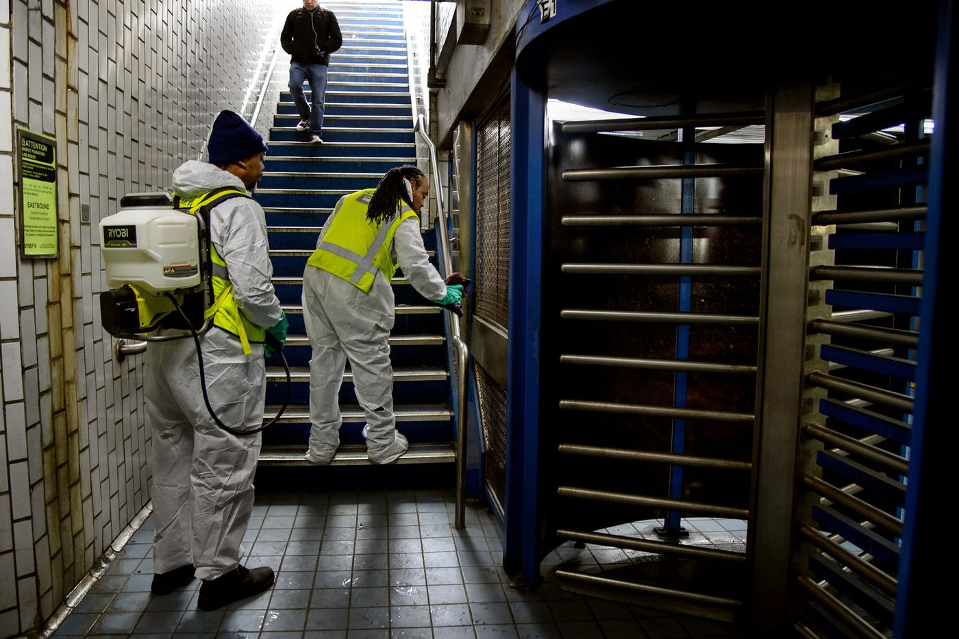 SEPTA maintenance workers Janil Brown and Ira Davis (right) clean the handrails at the entrance to the Market-Frankford 2nd Street Station on Wednesday. The workers were in the station to demonstrate how they clean the subways (normally done at night after the stations close). l