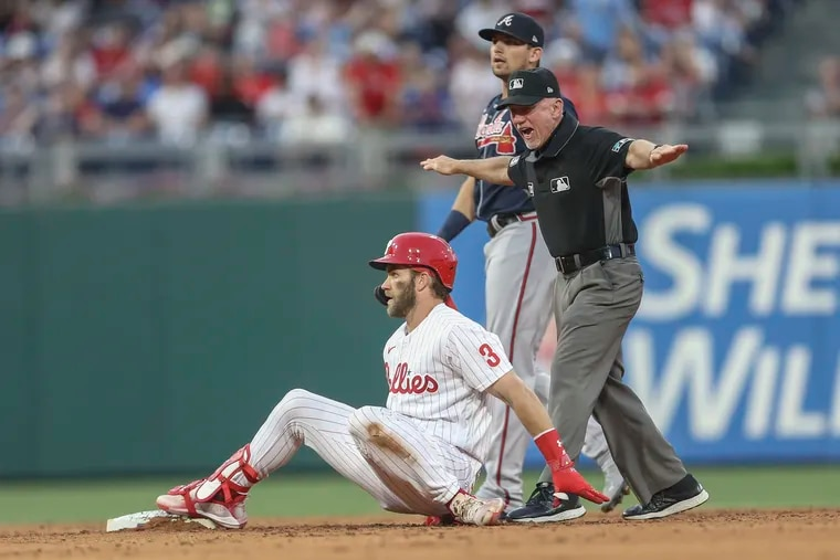 Phillies outfielder Bryce Harper falls back to second after hitting a double in the third inning Friday against Atlanta.