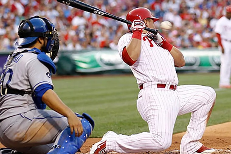 Carlos Ruiz ducks to avoid a brushback pitch in the third inning. (Yong Kim/Staff Photographer)