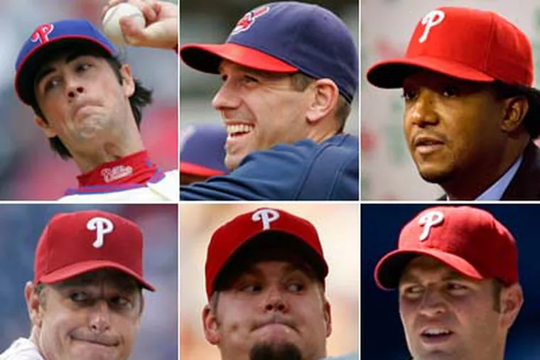 With the addition of Cliff Lee, Manager Charlie Manuel will have a tough time figuring out which pitcher gets demoted.      (Inquirer File Photos)