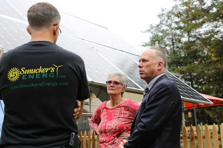 Stephen and Diane Van Schoyck speak with  Lancaster County renewable-energy contractor John Smucker (left) about the installation of new solar panels on their one-acre lot in Langhorne.