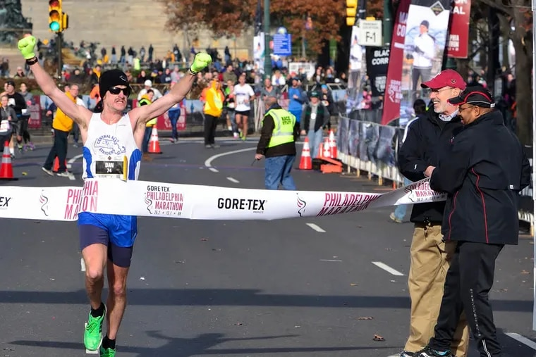 Dan Vassallo, 29, was the first marathon runner to cross the finish line on Sunday at the Philadelphia Marathon.  (C.F. Sanchez / Staff Photographer)