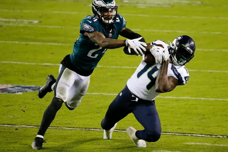 Seahawks WR DK Metcalf makes a tough catch past Eagles CB Darius Slay in the fourth quarter of Monday's game. The Eagles lost 23-17, falling to a 3-7-1 record.