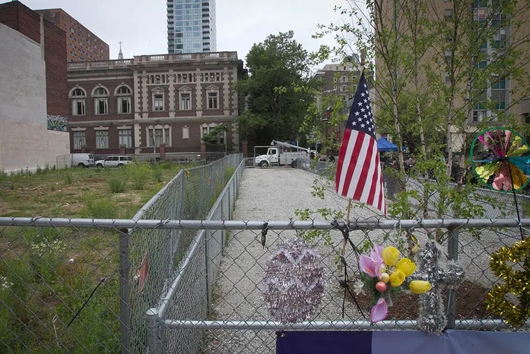 The memorial site that developed after the collapse of the Salvation Army Thrift Store at 22nd and Market streets on June 5, 2013. ( ALEJANDRO A. ALVAREZ / Staff Photographer )