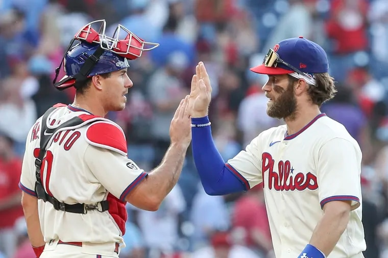 Phillies catcher J.T. Realmuto (left) and Bryce Harper are looking to bounce back from a difficult road trip.