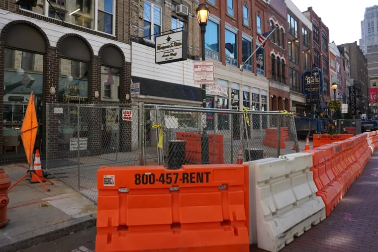 Barricades on Jewelers Row, where Toll Bros. City Living was approved to demolish structures and build a 16-story condo tower.
