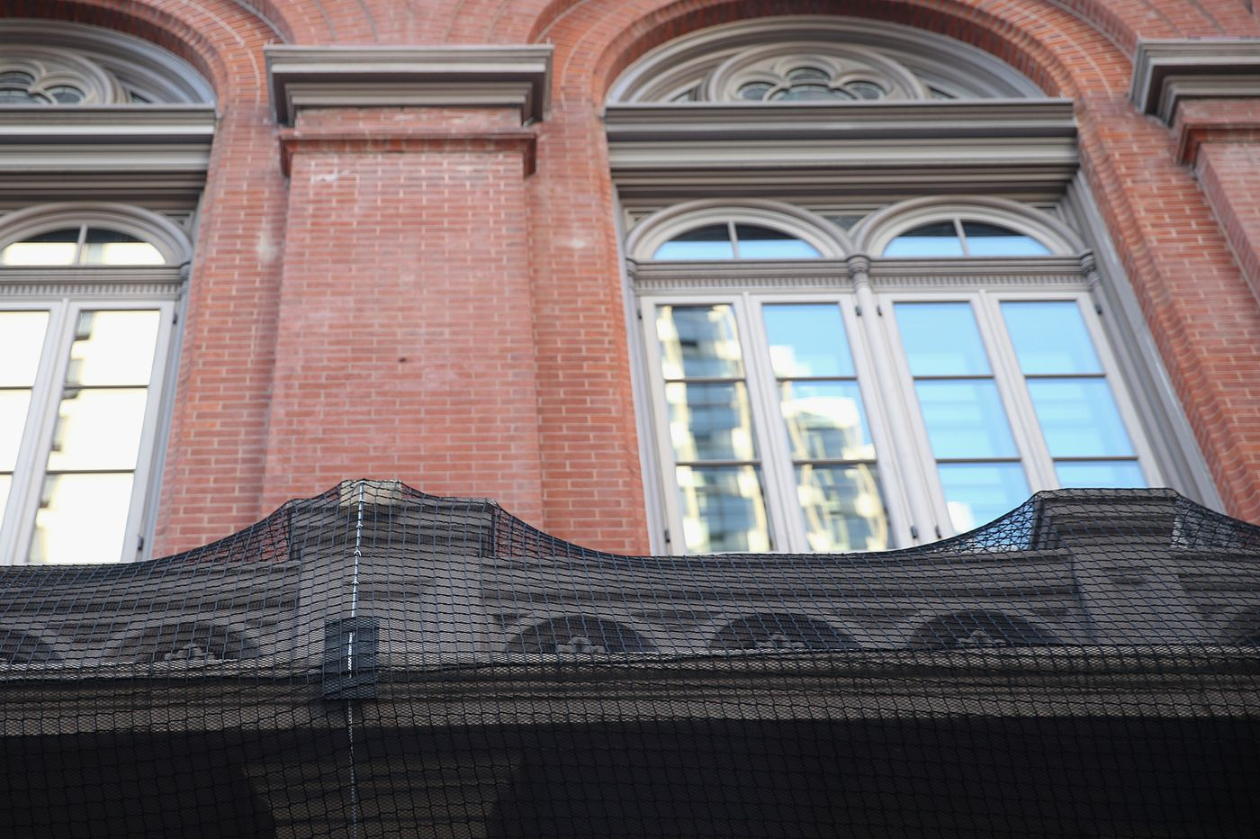 At Academy of Music, the sky is 'spalling': Netting now in place to protect patrons and passersby