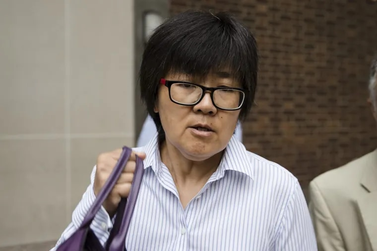 Yu Xue exits the federal courthouse in Philadelphia, Friday, Aug. 31, 2018. Xue, a cancer researcher, pleaded guilty to conspiring to steal biopharmaceutical trade secrets from GlaxoSmithKline in what prosecutors said was a scheme to set up companies in China to market them.