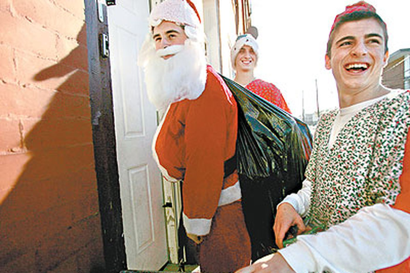 Teen Santas deliver to the less fortunate