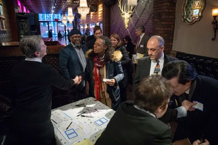 Candidates running for Council at-large along with other guests check in at the Rosewood bar before heading inside to Woody's for a candidate meet and greet on Tuesday, March 05, 2019.