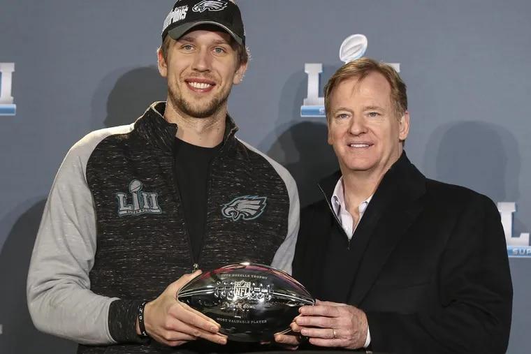Eagles quarterback Nick Foles receives the MVP award from NFL commissioner Roger Goodell.