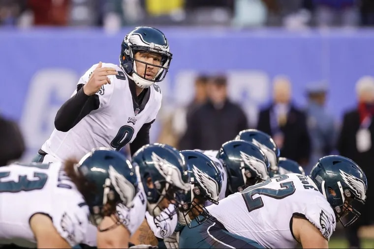 Eagles quarterback Nick Foles signals against the New York Giants on Sunday, December 17, 2017. YONG KIM / Staff Photographer