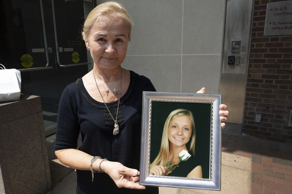 Two friends shared heroin in a KFC bathroom. One died, one went to prison. Their families are picking up the pieces.