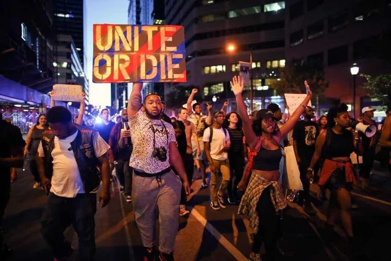 Black Lives Matter demonstrators march along Market Street on Sunday, July 10, 2016, in Center City.
