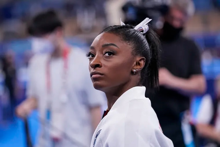 Simone Biles waits for her turn to perform during the Olympics artistic gymnastics women's final on Tuesday in Tokyo.