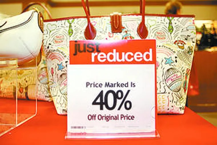 Discounted purses at a Denver Macy's. Retailers expect an increase in returns after the holidays.