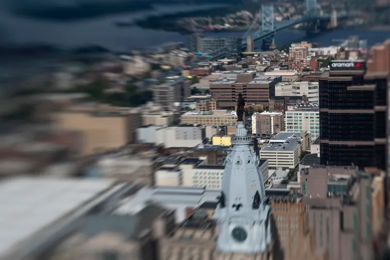 The statue of Billy Penn and observation deck, on top of City Hall, can be seen from the 57th floor of Liberty One Observation Deck .
