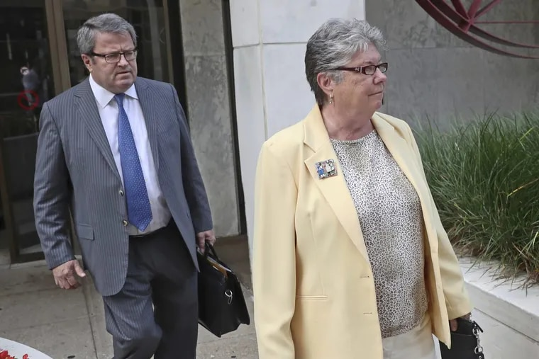 Former Pa. Treasurer Barbara Hafer (right) and her attorney, John Knorr, walk out of the federal courthouse in Harrisburg.