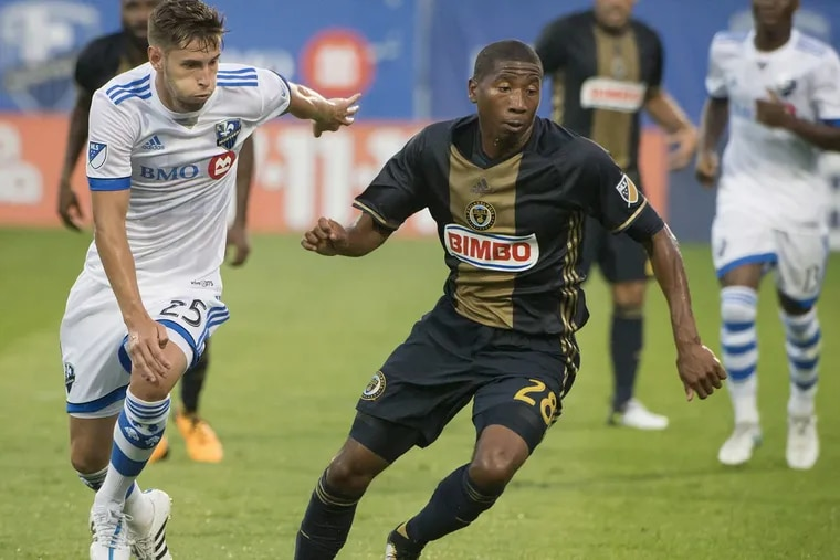 The Union's Raymon Gaddis (right) looks to control the ball against Montreal  on July 19.