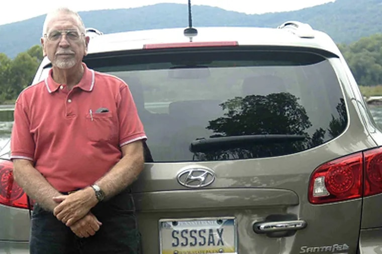 George Snokes, of Mechanicsburg, Pa., with the SSSSAX vanity plate on his Hyundai Santa Fe. (Photo by Susan Ecenbarger)