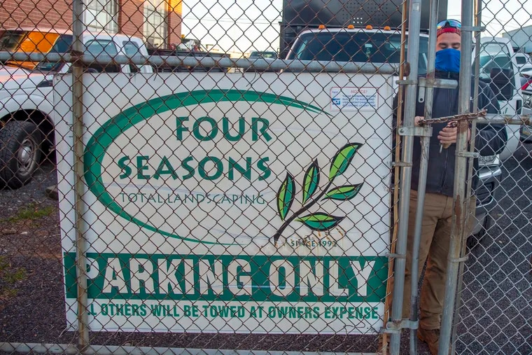 The scene along State Road in the Holmesburg neighborhood of Philadelphia, Nov. 18, 2020, where employee Ken Moran locks up the gate at Four Seasons Total Landscaping. It was eleven days earlier that the company was thrust into the international spotlight when Rudy Giuliani, an attorney for president Trump, hosted a press conference at the company's rear garage door on the status of the Trump campaign's legal challenges to Pennsylvania's ballot-counting process. Political pundits peculated that the campaign meant to book the upscale Four Seasons Hotel.