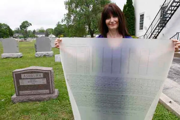 Christine McGuire of Gladwyne, PA with a drawing of cemetery plots behind the Gladwyne United Methodist Church. Developers want to move the resting place of Phillies announcer Richie Ashburn from his grave behind the Gladwyne United Methodist Church at 316 Righters Mill Road in Gladwyne, PA. Photograph from Thursday, May 23, 2013. ( ALEJANDRO A. ALVAREZ / STAFF PHOTOGRAPHER )