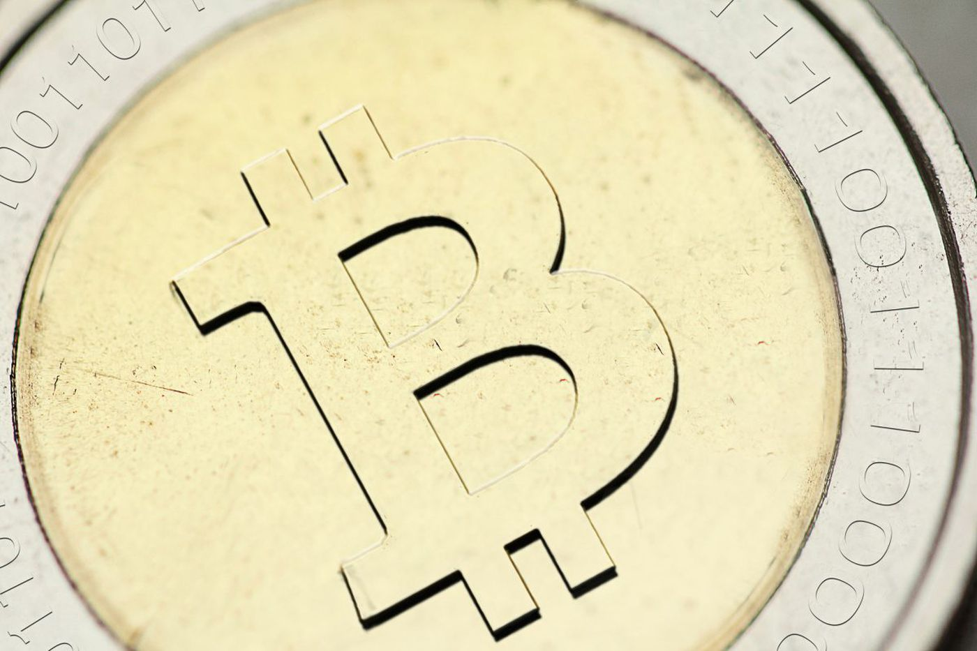 You can't hold a bitcoin, but the web currency's value has skyrocketed. Why?