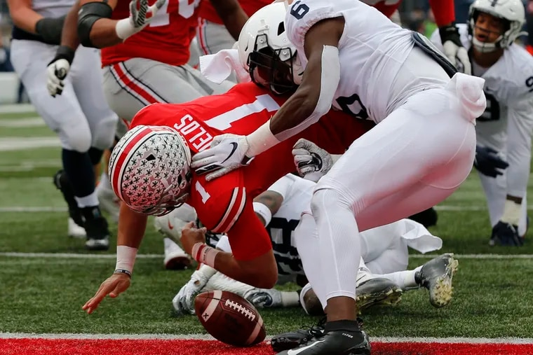Penn State linebacker Cam Brown (right), shown causing Ohio State quarterback Justin Fields to fumble the ball before crossing the goal line in last Saturday's game against Ohio State, is one of 16 seniors playing his final game Saturday at Beaver Stadium.
