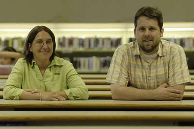 Singing the praises of a collection agency that uses seminary students are director Martina Kominiarek and Det Ansinn at the Bucks County Free Library. (Jonathan Wilson/Inquirer)
