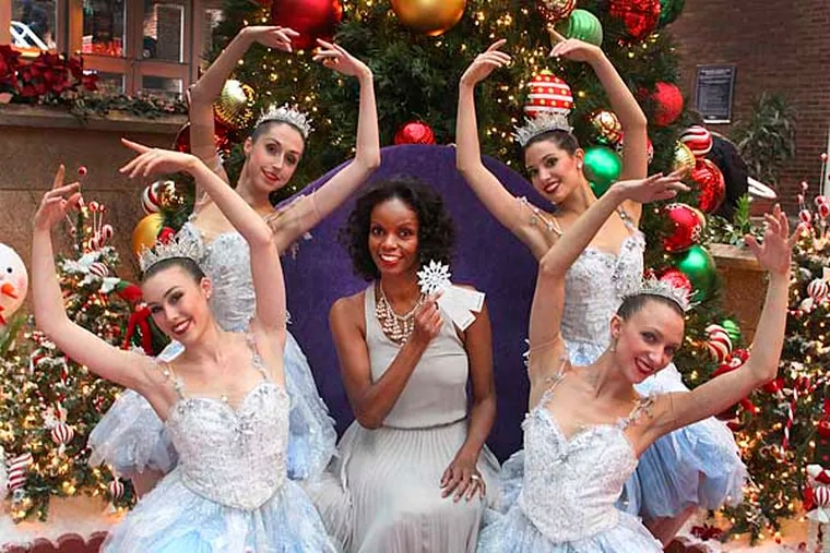 Pennsylvania Ballet's Nutcracker snowflake dancers for a photo for Jenice's annual Oprah-style My Favorite Things Holiday Gift Giveaway, Tuesday, November 20, 2012.  Front row (l-r) Elizabeth Mateer, Holly Lynn Fusco, Jenice, center, top (l-r) Evelyn Kocak.  (  STEVEN M. FALK/ Staff Photographer )