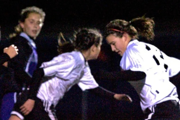 Haddonfield's Katie Johnston (right) has a chance to score. The Bulldogs lost their first conference game in five years.