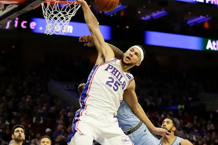 Ben Simmons gets fouled while trying to dunk over Jaren Jackson during the second quarter.