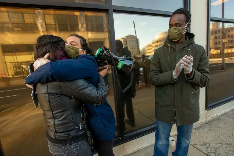 Christian M'Bagoyi (right), his wife Sarika (center), and Erika Guadalupe Núñez, executive director of Juntos, celebrate outside the Philadelphia ICE office on Feb. 26, 2021, after Christian was not deported. A West African immigrant, he faced deportation or detention from ICE and had no criminal record.