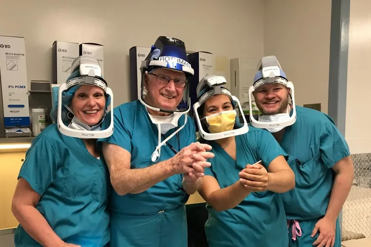 Before performing his last knee replacement, surgeon Richard Rothman prepared to scrub with his operating room team. Pictured, from left to right, are Linda Minda, first assistant; Richard Rothman; Amanda Hetzel, scrub nurse, and Shawn DeNight, hook holder.
