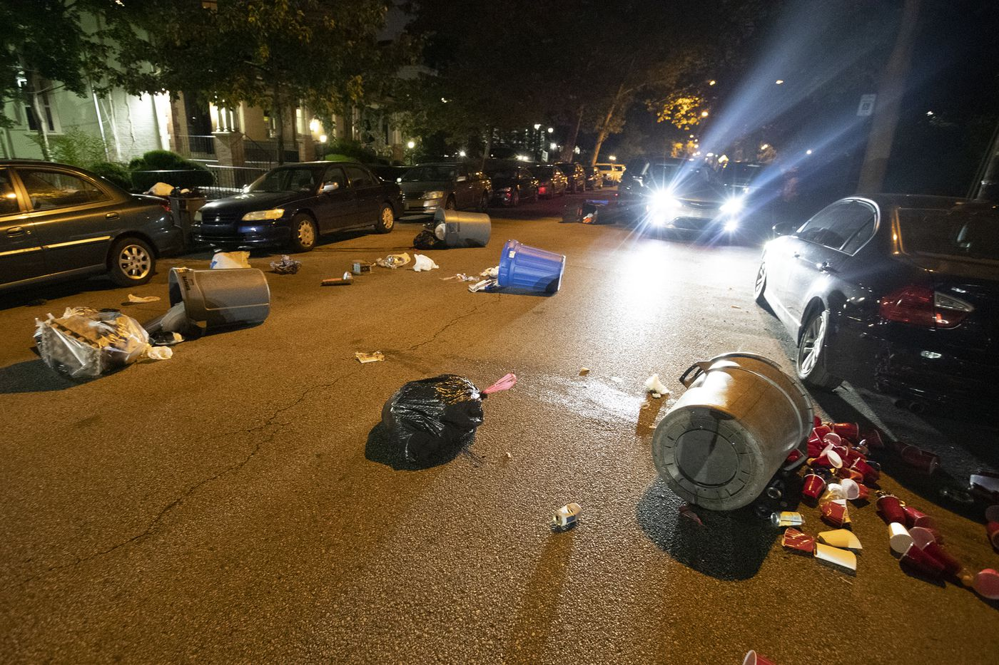 Garbage cans thrown in the street by a group of protesters marching in response to the Jacob Blake shooting in Wisconsin. Numerous windows were shattered at the University of Pennsylvania.