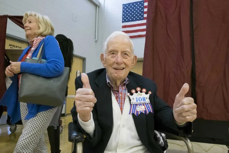 Bill Mohr, a 108-year-old W.W. II veteran, gives two thumbs up after casting his vote in the 2016 election at Upper Moreland High School in Willow Grove.
