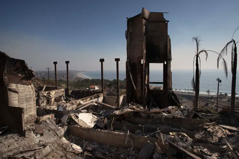 FILE - In this Nov. 11, 2018 file photo, a home burned down by a wildfire sits on a hilltop overlooking the Pacific Ocean in Malibu, Calif. Authorities estimate it will cost at least $3 billion to clear debris of 19,000 homes destroyed by California wildfires last month. State and federal disaster relief officials said Tuesday, Jan. 11, that private contractors will most likely begin removing debris in January from Butte, Ventura and Los Angeles counties and costs are likely to surpass initial estimates. (AP Photo/Jae C. Hong, File)