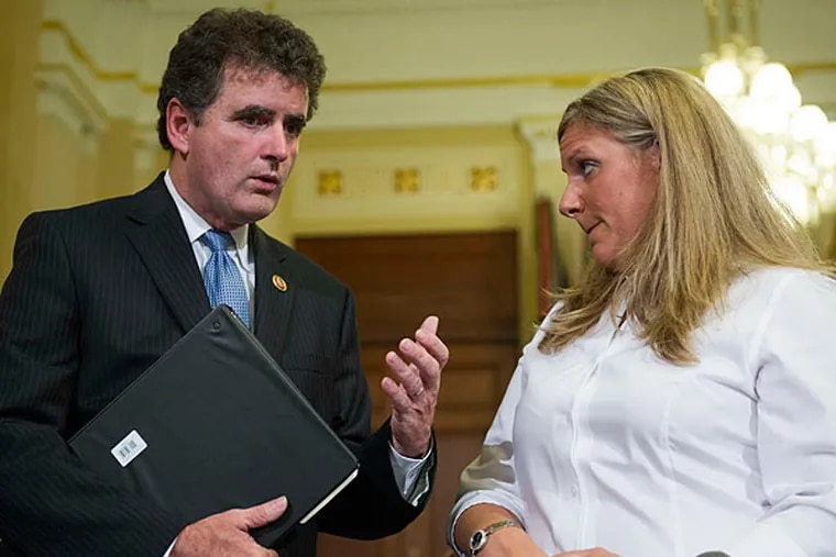 Rep. Mike Fitzpatrick (R., Pa.) talking with Kristen Ruell, a seven-year employee of the VA and one of its most prominent whistle-blowers, before a House Committee on Veterans Affairs hearing in July.