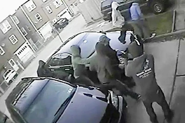 A group of six thugs ambushed a Korean American business owner and his wife at about 7 p.m. on March 18, 2012, in the rear driveway of their home on McKinley Street near Castor Avenue in Oxford Circle. (Still from surveillance video)