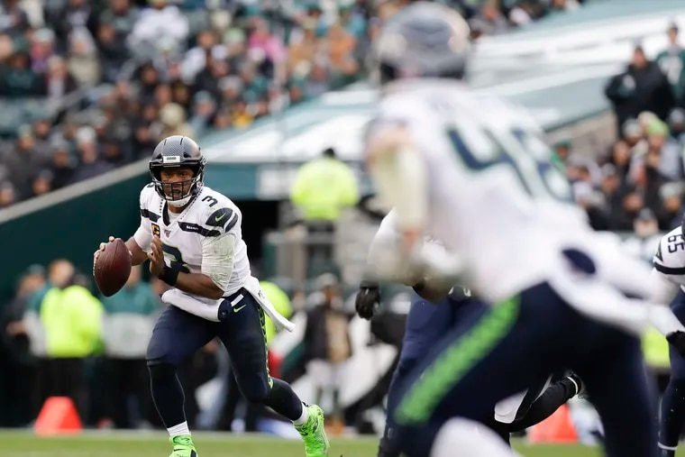 Seattle Seahawks quarterback Russell Wilson looks for a receiver against the Eagles in November.