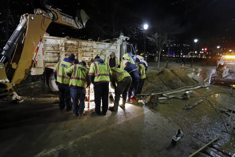 Philadelphia Water Department crews are seen here examining the section of a water main that broke on Wednesday, Dec. 20, 2017, on 18th Street near Locust on the east side of Rittenhouse Square.