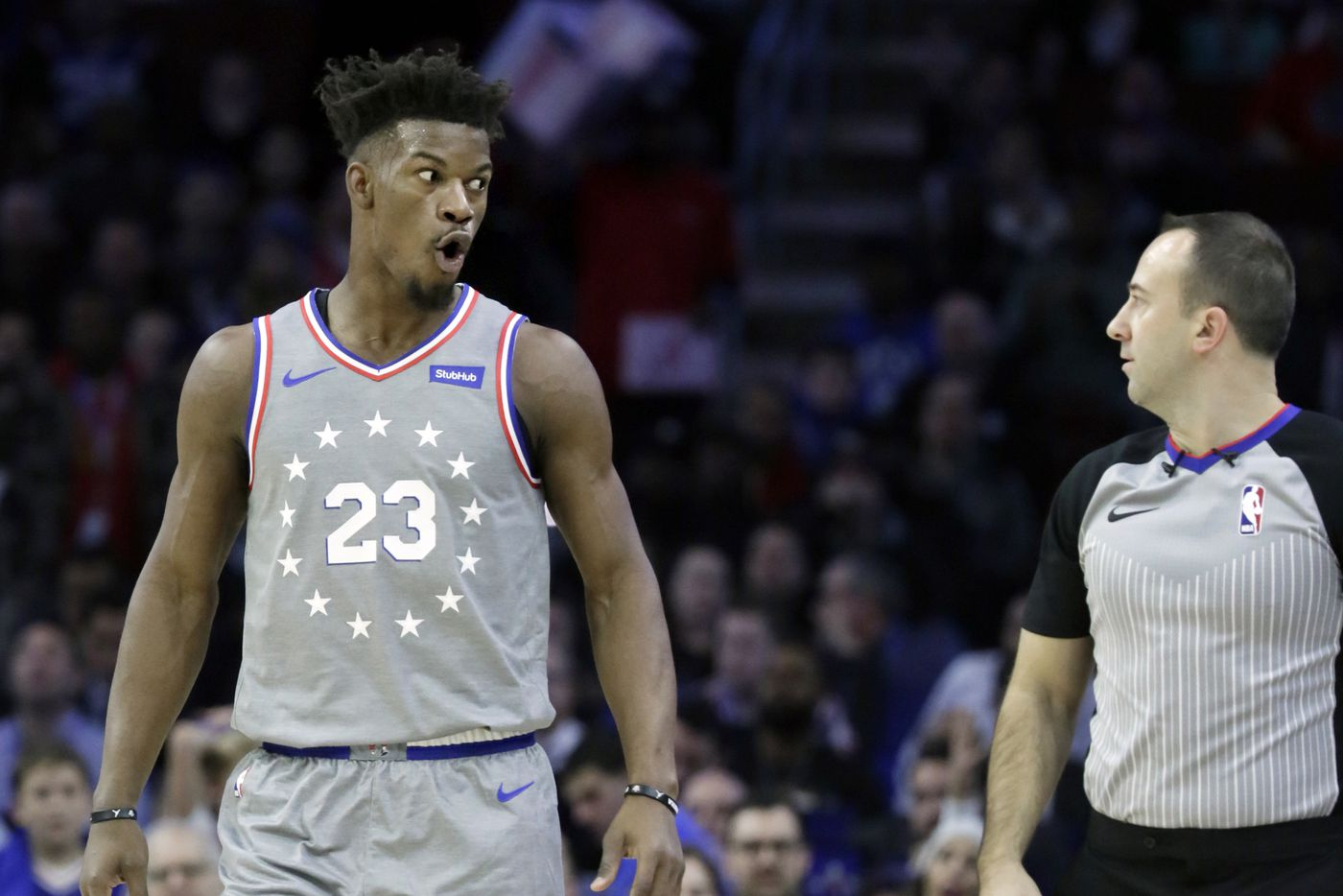 16854a3653f Sixers guard Jimmy Butler reacts after being charged with goaltending  during the Utah Jazz vs.