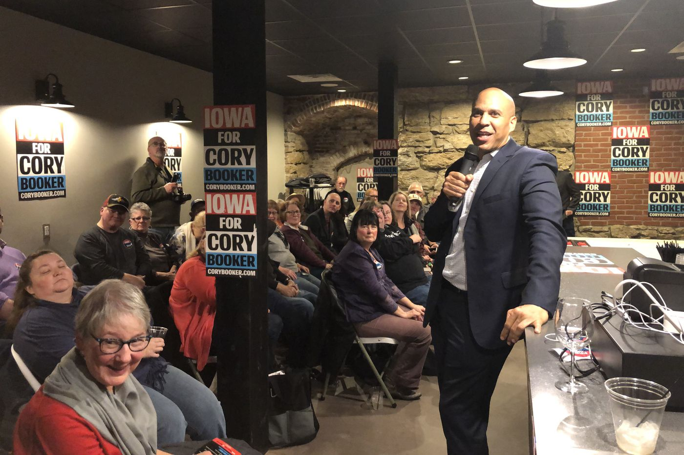 Cory Booker probably won't qualify for the next presidential debate. But he says he's not quitting.