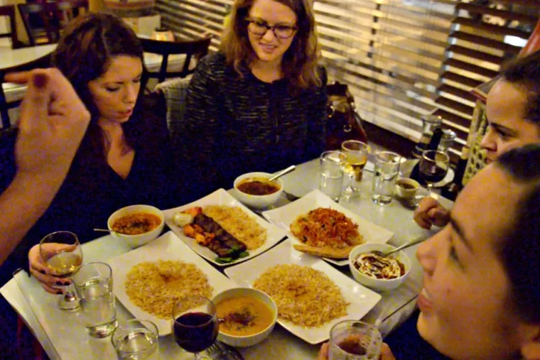"""Law school friends - (clockwise from left) Jacqueline Robbins, Rachael Eisenberg, Kenisha Marks, and Melissa Pang - who meet monthly at local restaurants and call themselves the """"Fat Four Dining Club,"""" at Sansom Kabob House."""